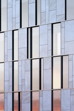 Limestone, glass and steel curtain wall facade detail at One Vandam in NYC by BKSK Architects.