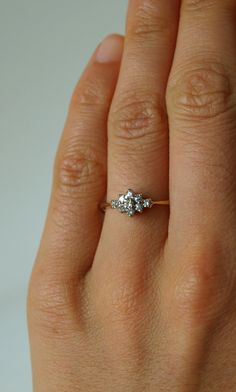 This is a valid contender for engagement rings.  Beautiful Diamond Snowflake Petite Vintage Estate by foxinebemine, $229.00