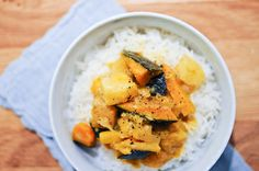 """Winter Vegetable Curry: (2 1/2 pounds) mixed cold weather vegetables, such as carrots, parsnips, potatoes, kabocha, broccoli, cauliflower, etc.,   2 tbsp evoo,   1 medium onion, finely sliced,   1 tsp fine sea salt,   a """"thumb"""" of fresh ginger, about 1 inch length, peeled and cut into thin matchsticks,   4 cloves,   1/4 tsp ground cinnamon,   13 1/2 oz coconut milk,   freshly ground black pepper."""
