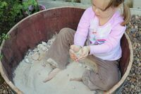 Love the wine barrel sand box and stumps