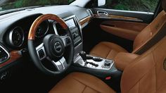 Overland features standard ventilated front seats, real Olive Ash burl wood steering wheel, leather-wrapped and stitched instrument panel and armrests, Keyless Enter'n Go™, Infrared Dual Zone Climate Control and more.