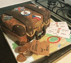 Suitcase cake made by me!! Booked a surprise Birthday getaway to Prague for my partner. What better way to tell him than cake?!