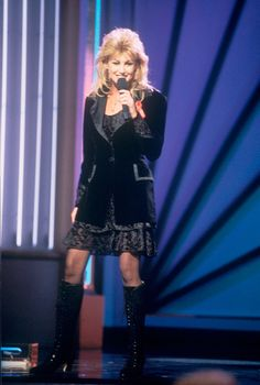 "Faith Hill makes her CMA Awards debut with ""Wild One"" at ""The 28th Annual CMA Awards"" (10/5/1994)."