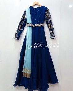 Grab this stunning dress now. Beautiful royal blue color floor length dress with ice blue color dupatta. Dress with waist belt. Dress with floral design hand embroidery work on sleeves. Stunning Dresses, Stylish Dresses, Fashion Dresses, Long Gown Dress, Anarkali Dress, Indian Gowns Dresses, Pakistani Dresses, Indian Long Gowns, Indian Attire