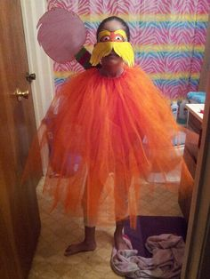 Lorax! Dr.suess week at my daughters school, today they get to dress up as a dr.suess character. I printed the mask online, tulle nd ribbon for the body, cardboard nd pipe cleaners for the tree