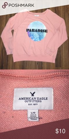 American Eagle Paradise Sweatshirt American Eagle Paradise Sweatshirt. Size Large. Great condition. Color is a coral peach. American Eagle Outfitters Tops Sweatshirts & Hoodies