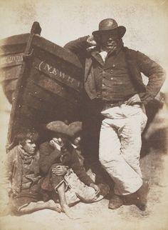 "David Octavius Hill and Robert Adamson, ""Sandy (or James) Linton, his boat and bairns"" (June 1845), calotype print (courtesy Scottish National Portrait Gallery)"
