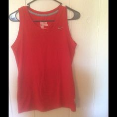 Nike dry fit cotton tee Sporty Nike sleeveless tee. Worn a  few times . Excellent condition . Beautiful coral red in color . Nike Tops Tees - Short Sleeve