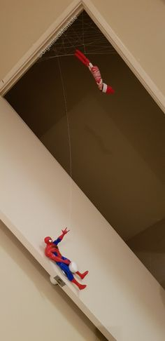 Elf on the shelf and Spider-Man seen to have had a falling out....