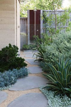 Blue stone pavers and a discreet garden shower.