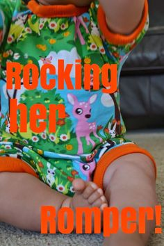 Rocking her romper (with her chunky little legs). Fabric from KitschyCoo.
