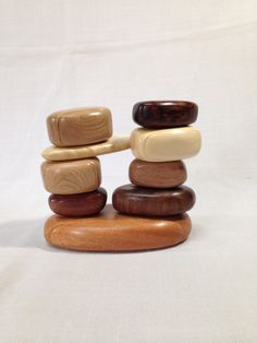 Handcrafted scroll sawn, sculpted wood keepsake or jewelry box designed to look like a pile of small rocks with four drawers. by SolsWoodworkingShop on Etsy