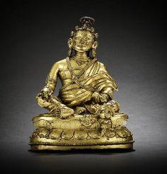 A gilt-bronze figure of a Mahasiddha  14th/15th century