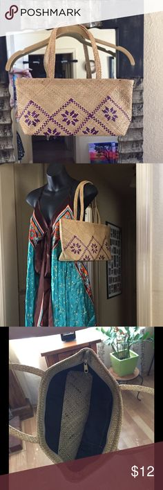 Basket Weave Shoulder Bag Basket weave bag with purple design on front, back is plain, double shoulder straps, with zipper top closure. Interior has black fabric with one pocket and bottom is basket weave. No tags but never used. Bags Shoulder Bags