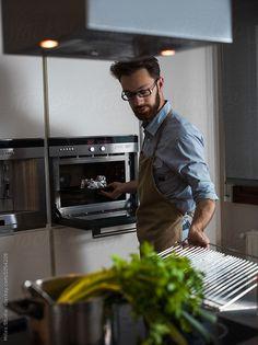 Man cooking vegetarian soup at home