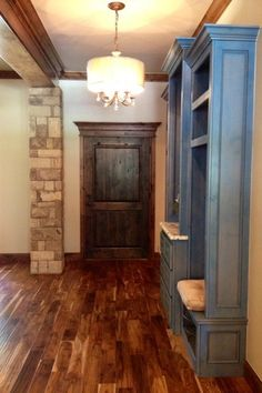 Traditional Entryway with Pendant light, Hardwood floors, Built-in bookshelf