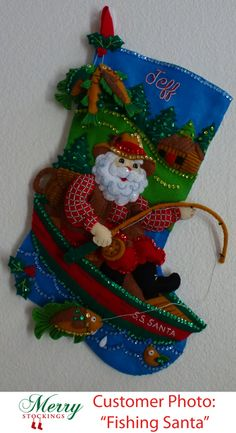 """Customer photo of completed kit sent to MerryStockings. Kit entitled """"Fishing Santa"""". Super cute, well done!"""