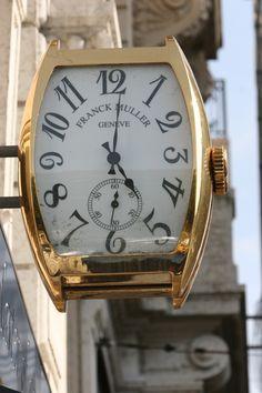Storefront clock in Geneva, Switzerland