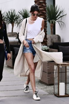 Kendall instantly dresses up a casual denim cutoffs and tee look with a flowy trench