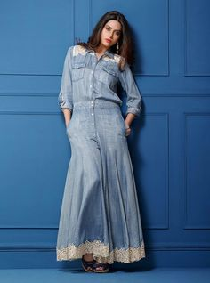 zainab chottani. Light denim jumpsuit with flowy lowers with French lace appliquéd on the bottom and on the yoke.
