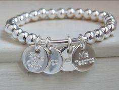 Pulsera con medallas en plata de 1ª ley. Totalmente personalizable. Más modelos en www.plata-design.es
