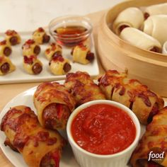 Everyone loves that easy, time-honored party snack known as pigs in blankets, but why not up your game for this season's football-party spread? We've created five exciting new flavor combinations! Finger Food Appetizers, Appetizers For Party, Appetizer Recipes, Snack Recipes, Cooking Recipes, Thanksgiving Appetizers, Yummy Snacks, Yummy Food, Snacks Für Party