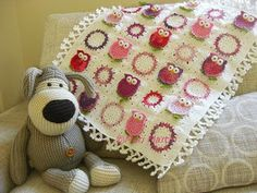 I'm gonna attempt something like this with my Uncle Richards granny squares. He loved owls!!!!!