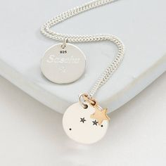 Silver Zodiac Constellation And Star Necklace. This beautiful, silver, zodiac constellation necklace includes a stunning silver zodiac charm and a star, hanging from a silver curb chain.