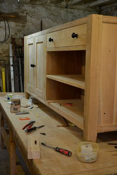 We design and make our bespoke kitchen furniture in our old stone workshop nestled on the edge of the Loire Valley. Our freestanding cabinets, bespoke kitchen islands and sideboards all have solid hardwood throughout. Where drawers are incorporated we use dovetailed joins and mortise and tenon joins on the construction of doors. We deliver within France and the UK. #kitchenisland #kitchenislandideas #kitchenislandfrance #furnituremaker #france #mayenne Bespoke Kitchens, Old Stone, Bespoke Furniture, Mortise And Tenon, Kitchen Furniture, Sideboard, Kitchen Island, Home, Island Kitchen