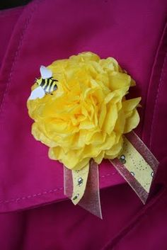 Paper carnation corsages. These would be great for Mother's Day for the ladies at church or in a nursing home. Would be pretty in other colors, with or without the bee and ribbon.