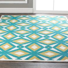 Modern Kaleidoscope Indoor Outdoor Rug A retro modern kaleidoscope pattern brings vibrant energy in shades of Turquoise with citron, or Yellow with gray. Create a happy oasis indoors or out, with the easy care qualities of these high performance rugs that are engineered to withstand UV rays and rain. 100% polypropylene