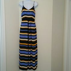 ON HOLD DON'T PURCHASEMichael Kors Dress Gorgeous Summer Michael Kors Maxi Dress with Front Slit and drawstring. 100% Polyester. Hardly Worn. MICHAEL Michael Kors Dresses Maxi