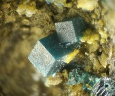 Boleite, KPb26Ag9Cu24Cl62(OH)48, Madonna di Fucinaia slag heaps, Campiglia Marittima, Campigliese, Livorno Province, Tuscany, Italy. Fov 2.5 mm. Well-formed boleite crystals. This seems to be the first find of the mineral in these slags. Copyright: © Bonifazi Marco