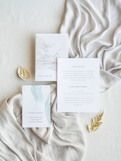 Natural and minimalistic style bridal editorial and feminine wedding details featuring modern ocean themes and pops of gold. #bridaleditorialphotography #modernbridalstyle #styleinspiration #accessories #modernminimalistbride