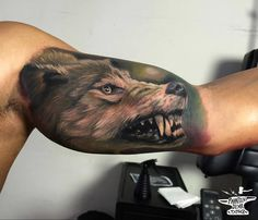 Snarling Wolf Bicep Tattoo http://tattooideas247.com/realistic-wolf-bicep/