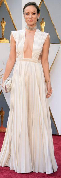 Olivia Wilde in Dress = Valentino Haute Couture  Jewelry – Neil Lane  Purse – Roger Vivier