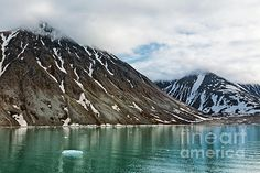Cloudy sky and mountains along the Magdalenafjord in Svalbard islands, Norway