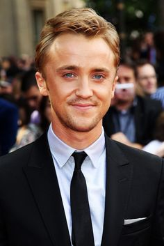"""Draco Malfoy (aka Tom Felton) has grown up into a handsome, suave young man! From the """"Harry Potter and the Deathly Hallows, Part 2"""" première happening now.    ps. Nice to see the Peroxide dye from 7 movies didn't damage his long suffering hair.."""