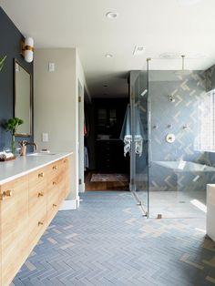 gorgeous grey-blue herringbone tiles in this modern master bath with a huge rainshower