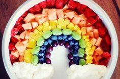 Go ahead; it's good for you. Rainbow fruit display that even the kids can help assemble.