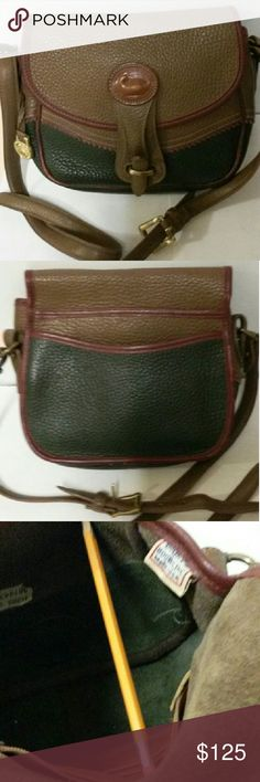 """Dooney & Bourke vintage Teton 1993 RARE Rare Tri colored bag has Ivy dark green bottom,rouge piping and trim,rare mushroom color flap & upper body. Very Rare,TRI COLORED, produced only from 1994 to 97. Hard to find esp in this condition! Sought after by collectors. Teton collections listed for 300$ & up on other sites and on PM too, look up dooney Teton bags!! This bag has the red/wht/blue tag inside as well as the """"original"""" white lot numbered slip inside. She has a Shiny Brass hanging Fob…"""