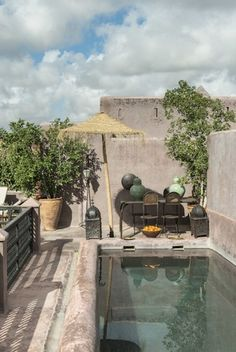 Morocco, The swimming pool in the terrace of Riad Dar Darma in Marrakech