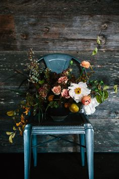 Fall bouquet with pinks and greens in a short vase on a metal dining chair with @crateandbarrel