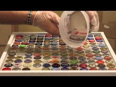 Bottle Cap table Top Tutorial , Want to make this in the kids new red , white and blue room. Maybe using Coke Tops? bottle crafts for kids Bottle Cap Bar Top Tutorial Bottle Cap Table, Beer Bottle Caps, Bottle Cap Art, Beer Caps, Beer Cap Table, Beer Bottle Glasses, Bottle Cap Coasters, Beer Cap Art, Blue Bottle