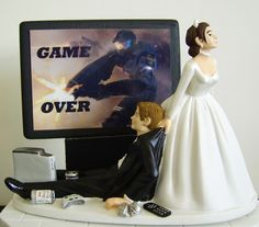 I love this!  Video game 'junkie' groom wedding cake topper - $69.95