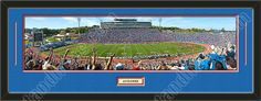 One framed large University of Kansas stadium panoramic with a customizable nameplate*, double matted in team colors to 39 x 13.5 inches.  The lines show the bottom mat color.  $139.99 @ ArtandMore.com
