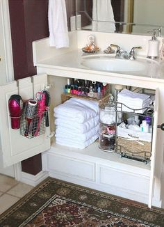 Sideways basket for a makeshift shelf. A few two tier shelving systems. An over the door organizer for hair dryer & brush.