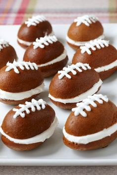 These mini football whoopie pies are made using boxed pumpkin bread mix in egg shaped muffin pans and cool whip for the icing.