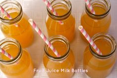 Milk bottles filled with fruit juice - a perfect accompaniment to any kids birthday party. www.notanotherslipperydip.com