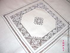 Linen tablecloth with white embroidery.